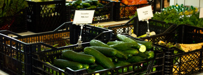 Cucumbers and other produce on display at one of our not-for-profit markets.