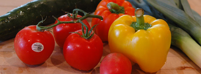 Fresh tomatoes, bell peppers and other produce available through our food programs.