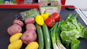 What a wrap! For less than $5, Quest offers organic tortillas, a pound of beans, 3 mangoes, 4 cucumbers, potatoes, lettuce, and green onions!